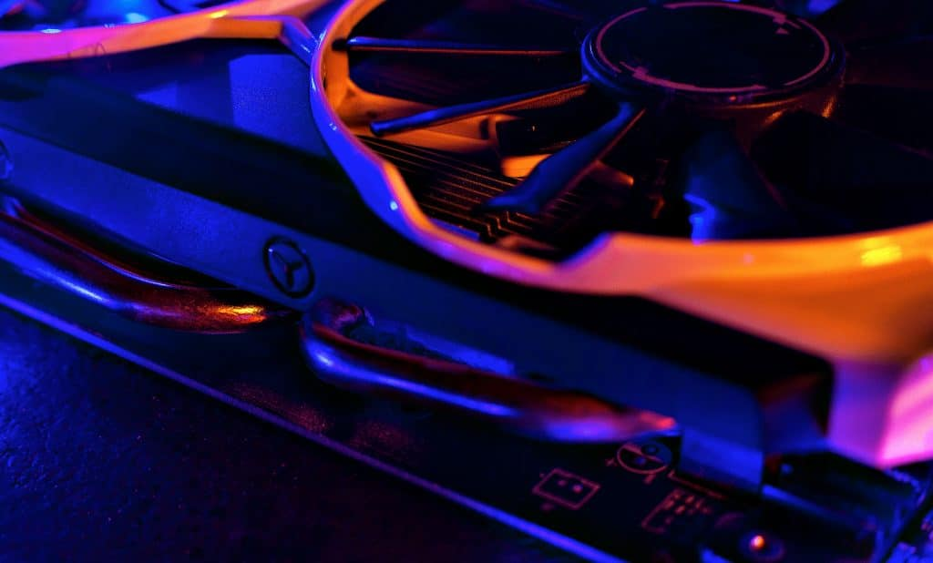 Graphics card in neon light. Cooling in a computer. Fan blade