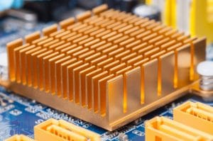 Copper heat sink  on computer motherboard abstract background