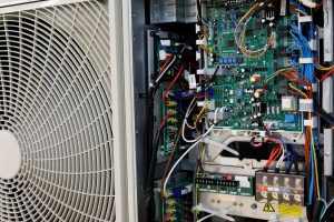 Circuit board of industrial air conditioner control system. Selective focus.