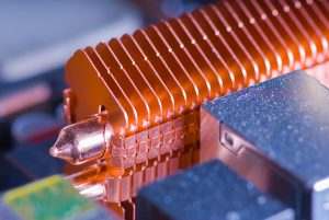 Copper heat pipe with dissipating fins on computer motherboard