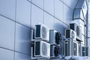 Outdoor air conditioning equipment. Air conditioners are located on the wall of the building.