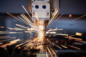 laser cutting. Metal processing on cnc laser machine with sparks