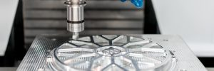 High precision CNC machining center working, operator machining automotive sample part process in factory