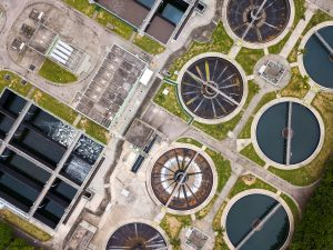 Fly drone over Sewage treatment plant
